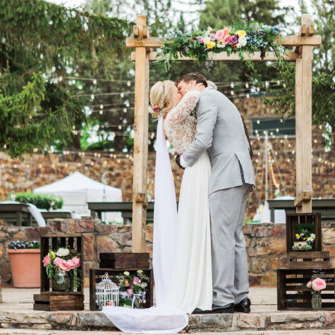 Ashley DeHart Photography | Bride and Groom Kiss at Ceremony, American Fork Amphitheatre