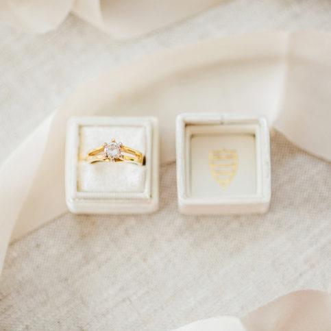 Ashley DeHart Photographpy | The Mrs Box ring shot on linen with ribbon